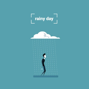 Business man standing under rain cloud rainy day problem concept
