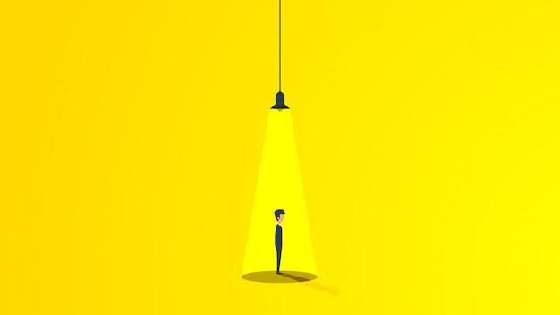 램프의 빛 아래에서 사업가