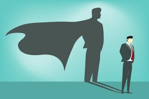 彼の影にスーパーヒーローを持つビジネスマン