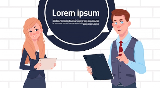Business man and woman holding tablet speak big chat bubble with text copy space