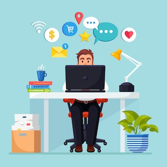 Business man working at desk with social network, media icon.