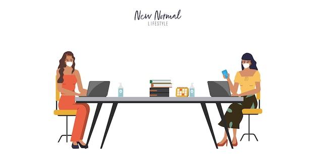 ビジネスオフィスの人々は、会議室と共同作業スペースで距離を保ちます。