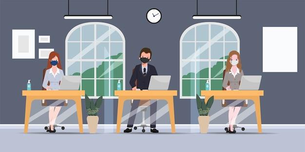 ビジネスオフィスの人々は社会的距離の事務室を維持します。仕事での新しい通常のライフスタイル。