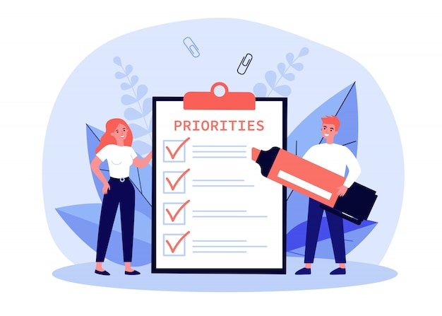 Business people filling out priorities list