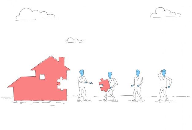 비즈니스 사람들이 그룹 빌드 하우스 팀 투자 함께 개념
