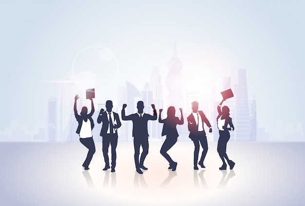 Business people group silhouette excited hold hands up raised arms, businesspeople concept winner success