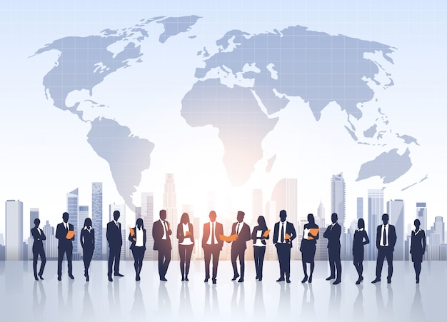 Business people group silhouettes over city landscape world map