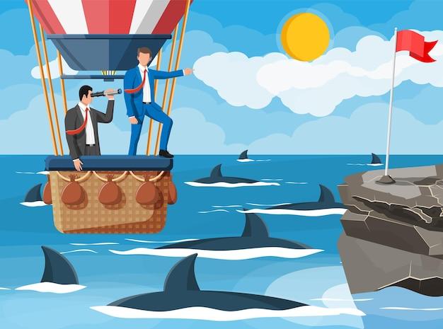 気球のビジネスマン、水中のサメ