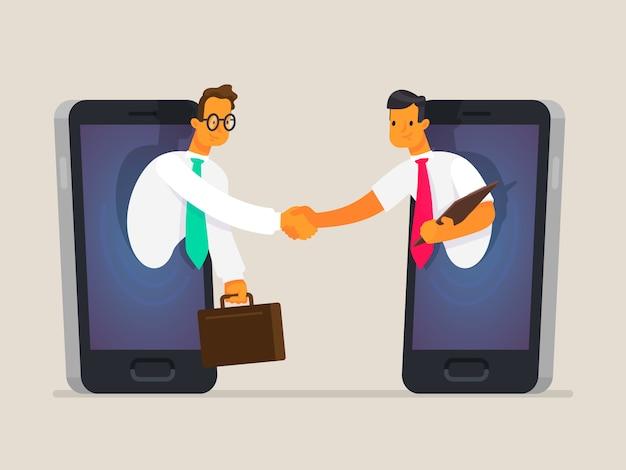 ビジネスの人々は、電話の画面で握手します。ビジネスコミュニケーションの概念