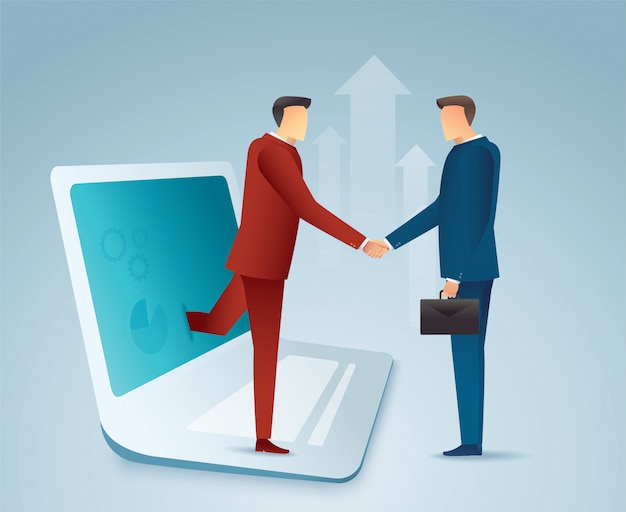 Business people shaking hands through laptop