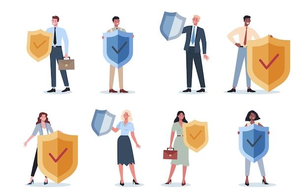 シールドセットを保持しているフォーマルなスーツを着ているビジネスマン。ビジネスの安全と保護の概念。