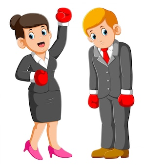 Business people with boxing gloves, business woman win and business men lose