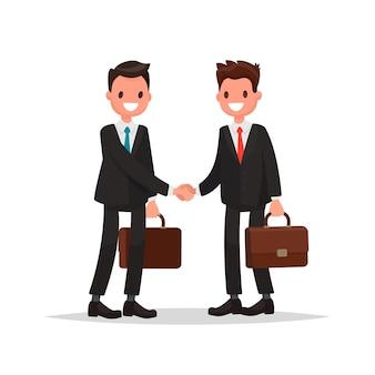 ビジネス関係。 2人のビジネスマンの握手。