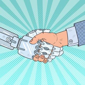 Business robot and human handshake