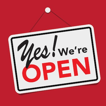 A business sign that says ' yes., we're open'