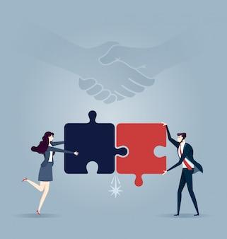 Business team assembling jigsaw puzzle