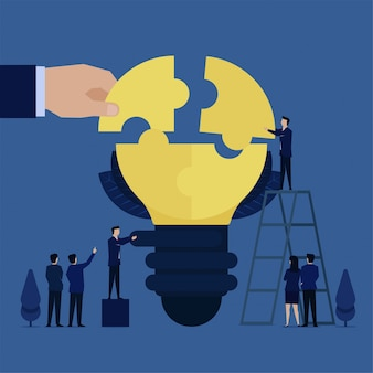 Business team build puzzle teamwork metaphor of idea building.