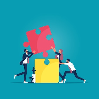 Business team connecting jigsaw puzzle symbol of teamwork cooperation partnership and success