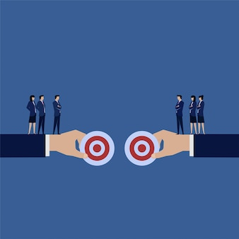 Business team debate to choose best target.