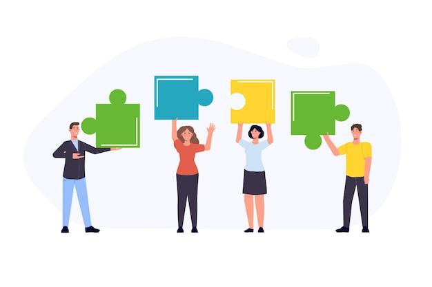 パズルのピースを保持し、接続するビジネスチーム