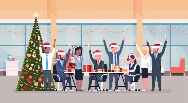 Business team raised hands in modern office decorated fir tree happy new year merry christmas celebration concept flat horizontal