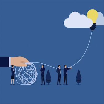 Business team release idea balloon to loosen tangled rope