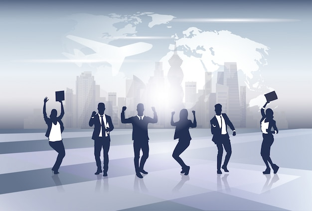 Business team silhouette businesspeople group cheerful happy raised hands over world map trip flight