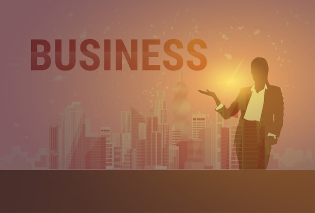 Business woman black silhouette open palm to copy space over modern city background