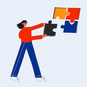 ビジネスウーマンが最後のパズルを挿入