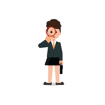 Business woman looking through a magnifying glass.