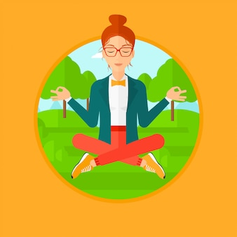 Business woman meditating in lotus position.