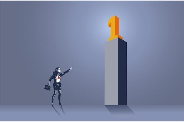 ナンバーワンのブルーカラーの概念の高い記念碑を指すビジネスウーマン