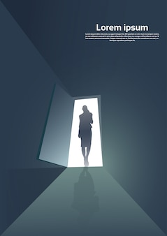 Business woman silhouette standing at door entrance new opportunity concept