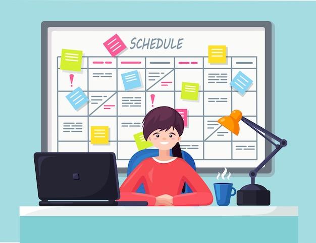 タスクボードコンセプトのスケジュール計画のデスクで働くビジネスウーマン。プランナー、ホワイトボード上のカレンダー。社員向けイベント一覧。チームワーク、コラボレーション、時間管理。