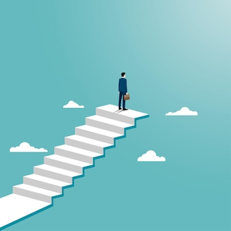 Businessman achievement concept. a man standing on top of a stair.