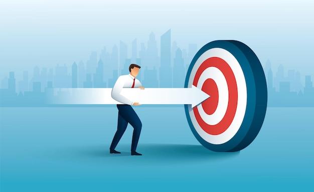 Businessman aims with huge arrow achievement goal