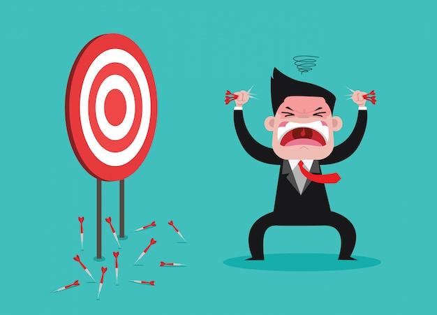 Businessman anger because not hits dartboard at a target