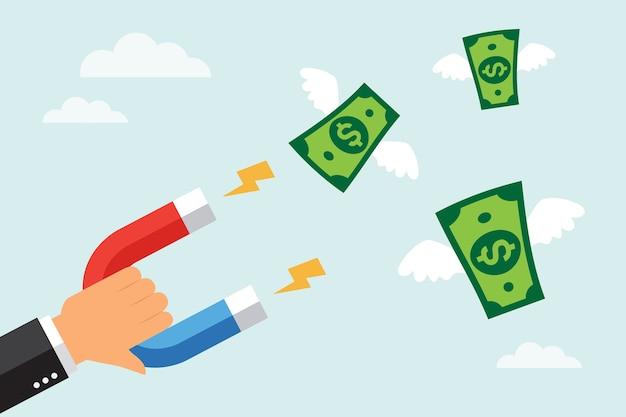 Бизнесмен привлекает деньги долларовую банкноту с помощью большого магнита