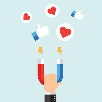 Бизнесмен привлекает социальные сети, как символы с большим магнитом