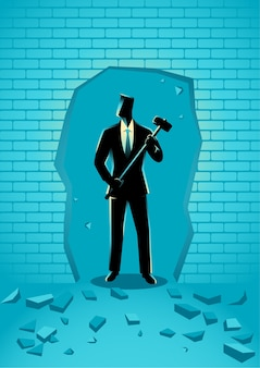 Businessman breaking the wall with hammer