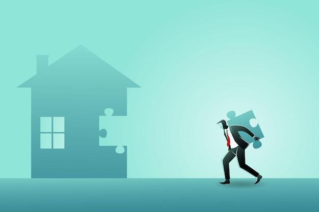 家を建てるためにジグソーパズルのピースを運ぶビジネスマン