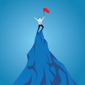 ビジネスマンの達成を祝って、山の頂上に旗を手に立っています。目的の概念。野心的な人々。ミッション成功