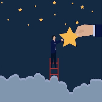 Businessman climb ladder to reach star from big hand metaphor of reach your dream.