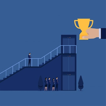 Businessman climb staircase while other wait on elevator to get trophy
