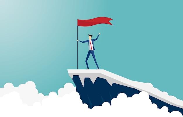 ビジネスマンは山の頂上に登ります。崖の上で成功を告げる旗を掲げてゴールに到達するリーダー。リーダーシップのビジネスコンセプト。成果、ビジョン