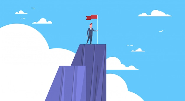Businessman climbed mountain, leader businessman on top concept of win and success