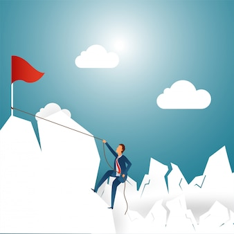Businessman climbing on mountain for achieving the goal.