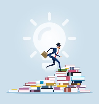 Businessman climbing to the top of book piles