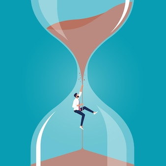 Businessman climbing up sand in hourglass losing time time management
