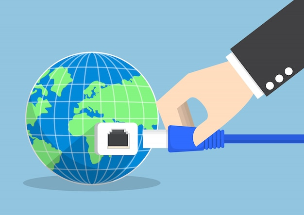Businessman connecting plug into the world